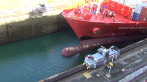 Freighter entering Locks, guided by mules - Panama